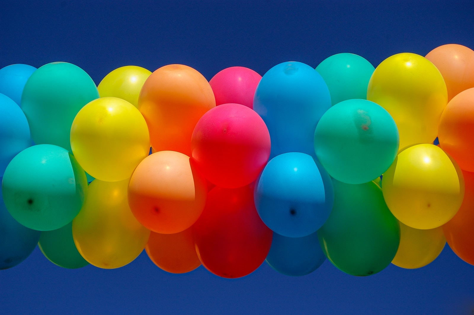 blue pink yellow and green balloons